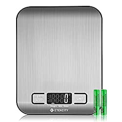 a kitchen scale with 2 batteries