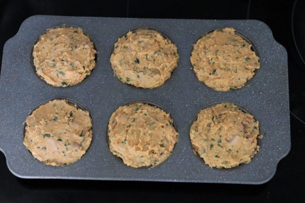 chicken muffin batter in muffin tin
