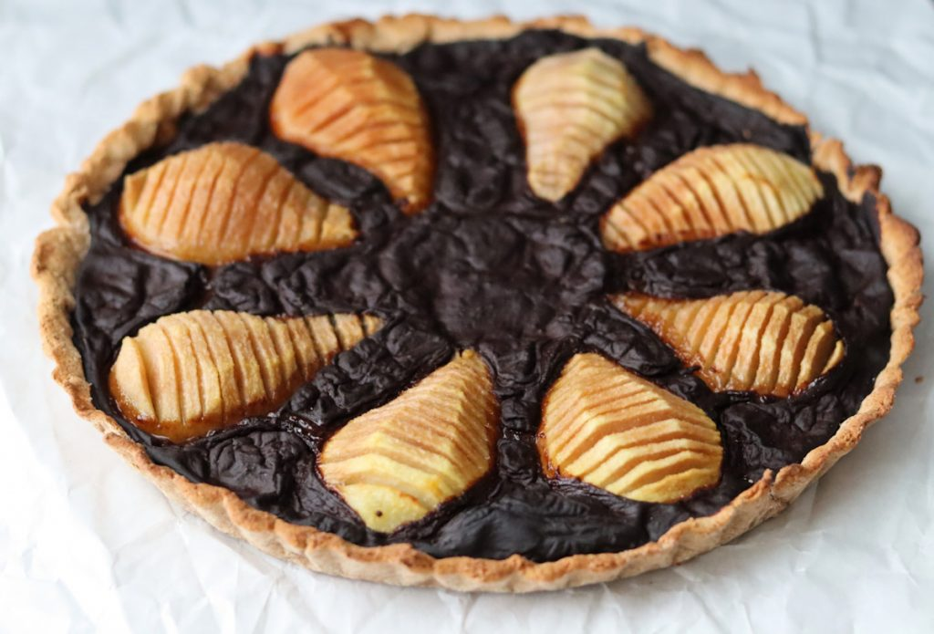 pear and carob tart on a white sheet