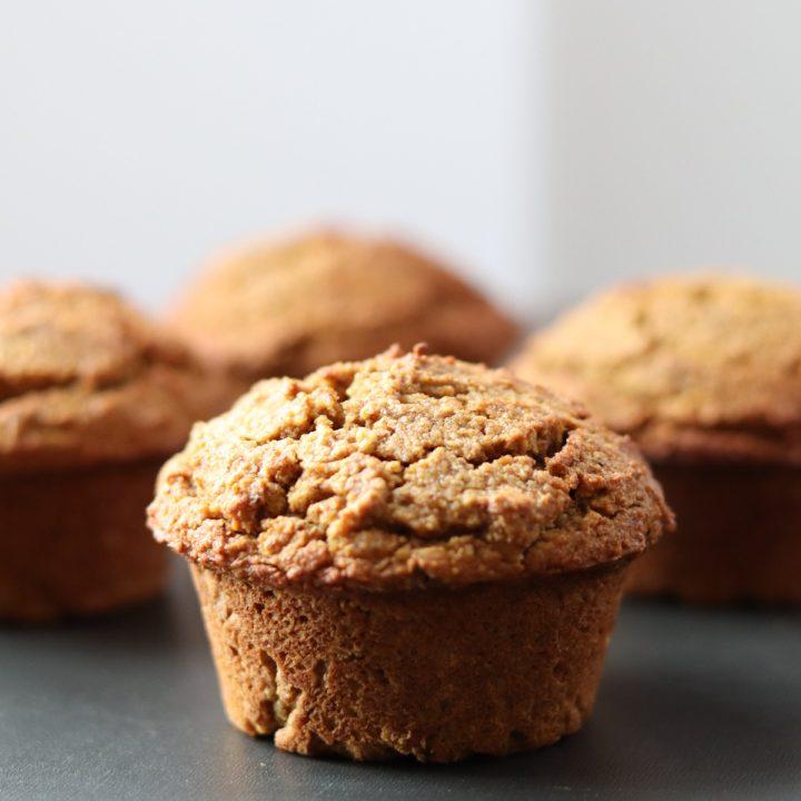 4 pumpkin muffins on a tray