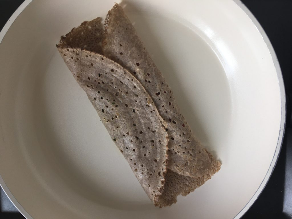 Folded buckwheat crepe in a skillet