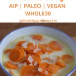 a graphic with a picutre of carrot coconut soup in a bowl and a text overlay with the title