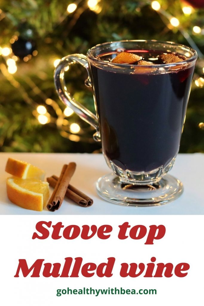a graphic with the picture of mulled wine in a glass cup and the title wrtitten in red and green