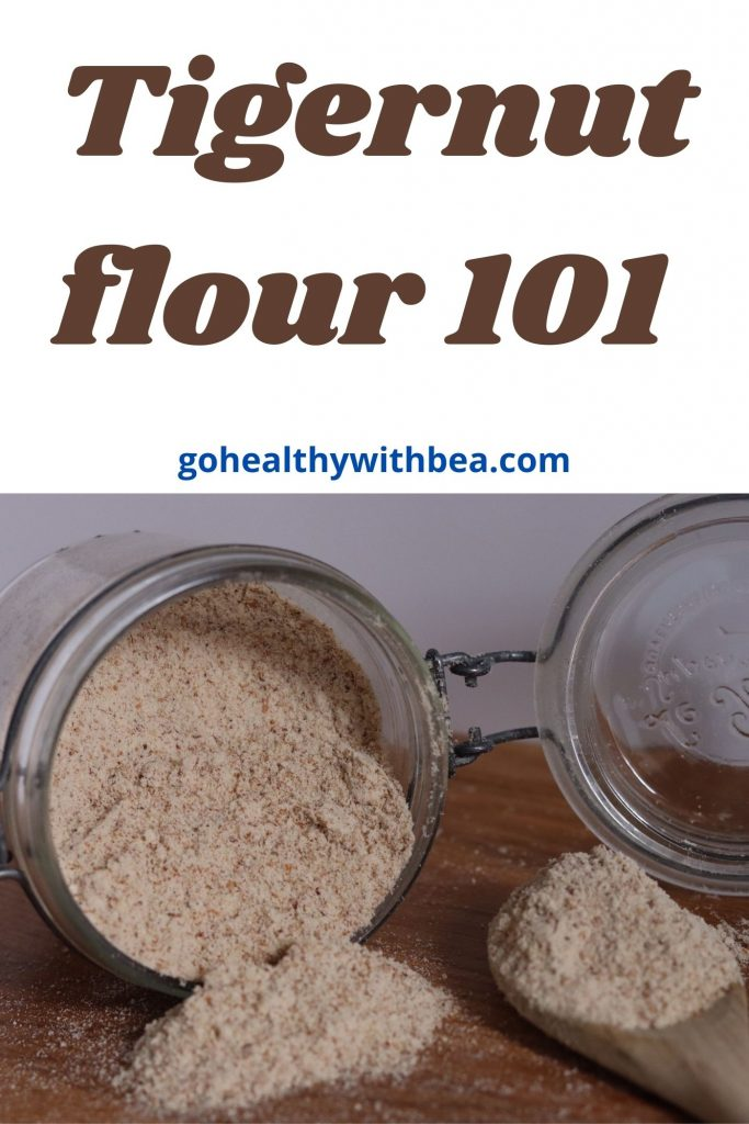 A jar and a wooden spoon full of tigernut flour