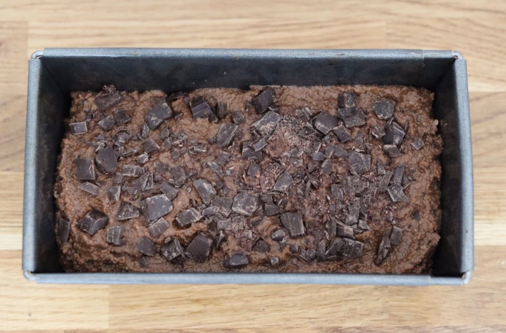 gluten free vegan chocolate zucchini bread batter in a tin before going in the oven
