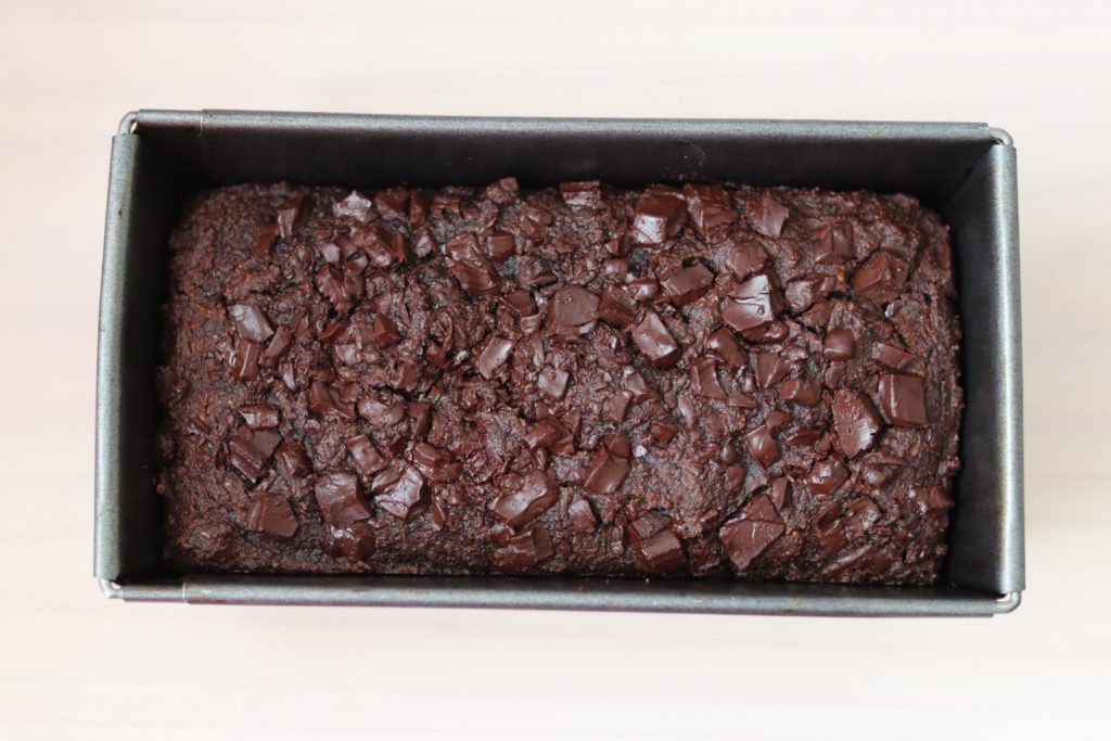 Double chocolate zucchini bread just out of the oven still in the tin
