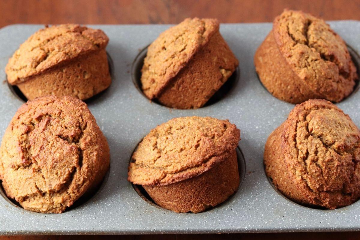 6 paleo pumpkin muffins on a muffin pan